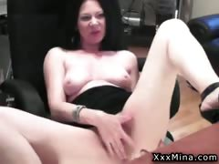 Sexy brunette girl masturbates her shaved cunt in front of
