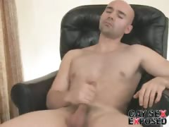Sexy bald gay Bucky jerking his giant dick on the armchair