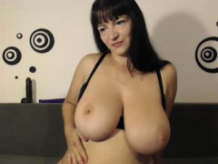 Curvy brunette in stockings reveals her huge boobs and toys