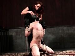 BDSM mistress ties up her slave and tortures him