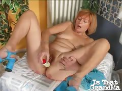 Charming granny Lady spreads pussy and fucks a giant white