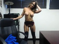 Naughty blonde secretary with glasses drops her clothes in