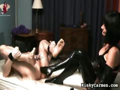 Carmen fucks a guy with fist and strap-on.