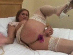 Mature TS dildoing her ass and sucks the toy