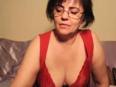 Insatiable brunette milf with glasses touches herself on th