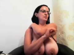 MILF with glasses shows her big boobs