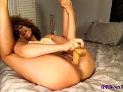 ebony babe riding a big dildo on webcam