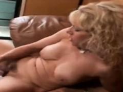 Mature blonde masturbates with vibrator